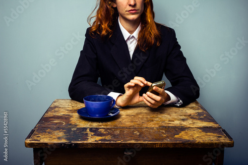 Businesswoman texting in coffee shop Canvas Print