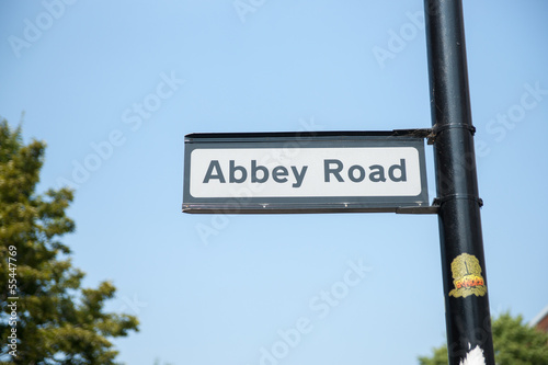 Photo  Abbet Road street sign against blue sky.