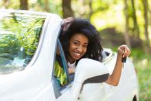 Young Black Teenage Driver Hol...