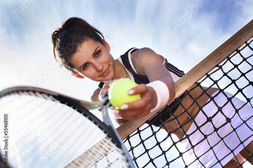 Beautiful young girl rests on a tennis net Wallpaper Mural