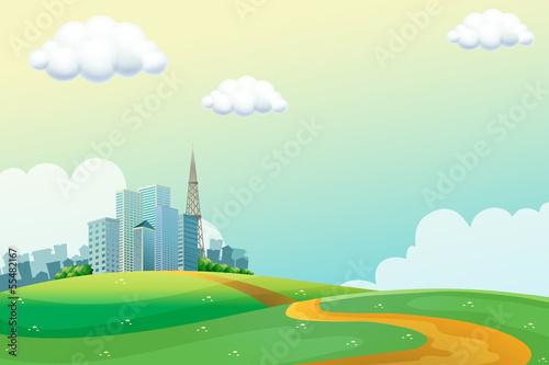 Spoed Fotobehang Lichtblauw Hills across the tall buildings