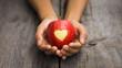 Leinwanddruck Bild - Red Apple with engraved heart