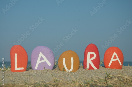 Laura, female name on colourful stones Canvas Print