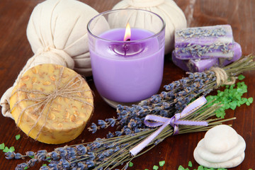Naklejka Still life with lavender candle, soap, massage balls, bottles,