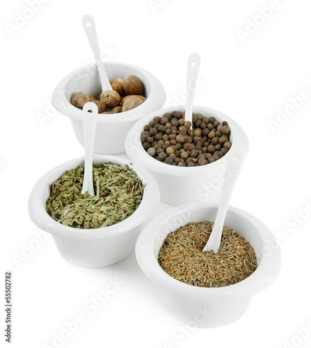 Tuinposter Kruiden 2 Assortment of spices in white bowls,