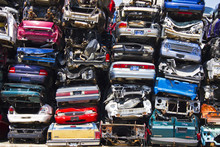 Discarded Junk Cars Piled Up A...