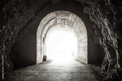 Photo Stands Tunnel Glowing exit from dark abandoned tunnel