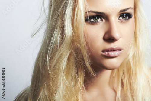 Fotografie, Obraz  Beautiful blond woman with disheveled hair.make-up