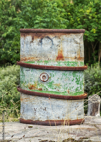 Old rusty steel barrel for fuel  - Buy this stock photo and explore