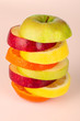 Stack of colorful sliced fruit with apple and orange