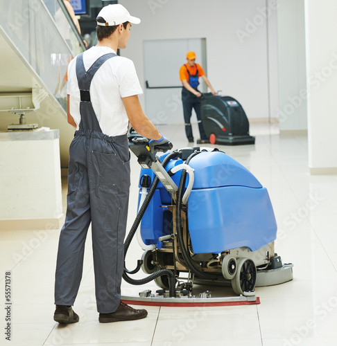 Fotografie, Obraz  male worker cleaning business hall