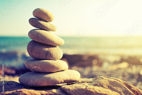 Foto auf Leinwand Zen-Steine in den Sand concept of balance and harmony. rocks on the coast of the Sea