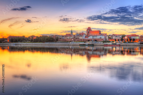 Poster Melon Torun old town reflected in Vistula river at sunset, Poland