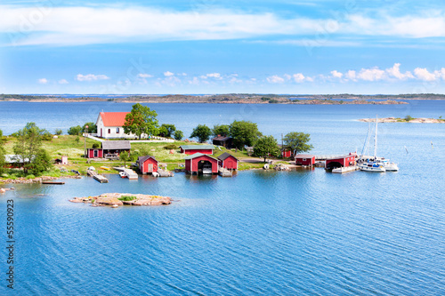 Stickers pour porte Scandinavie Small village with red buildings in Finnish archipelago