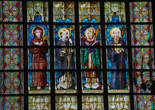 Roman Catholic Saints On A Stained Glass Window