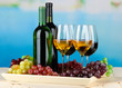Wine bottles and glasses of wine on tray, on bright background