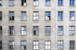 canvas print picture - old facade with sky mirroring in the windows