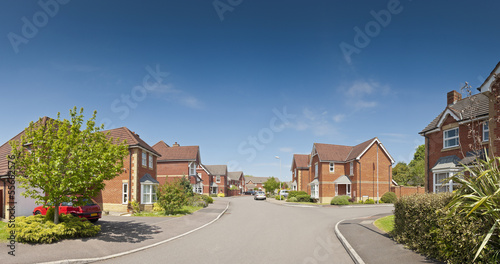 Picture perfect houses on newly built estate Fototapet
