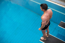 Man Standing On Diving Board A...