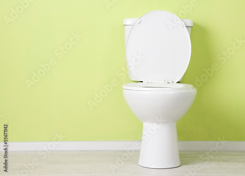 White toilet bowl in a bathroom Poster