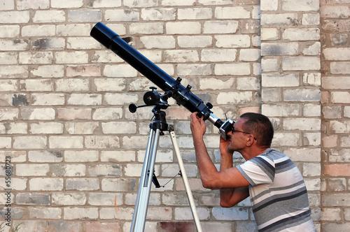 Adult man and telescope. Near Kiev,Ukraine Canvas Print