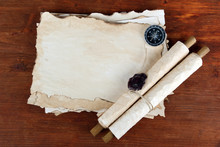 Old Paper, Scrolls And Compass On Wooden Background