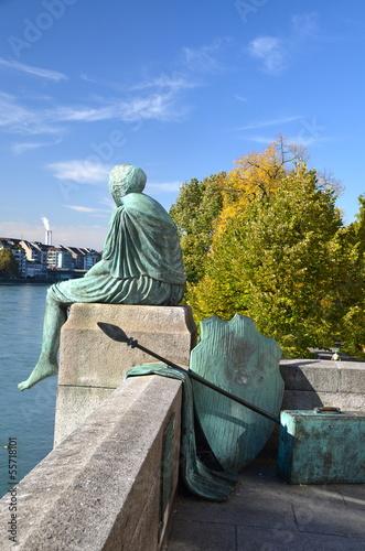 Sitting Helvetia statue on the river Rhine in Basel, Switzerland Canvas-taulu