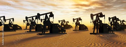 Fotografía Ölpumpen vor einem Sonnenuntergang