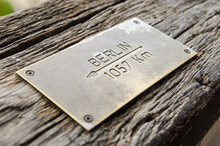 Distance Sign On Wood To Berli...