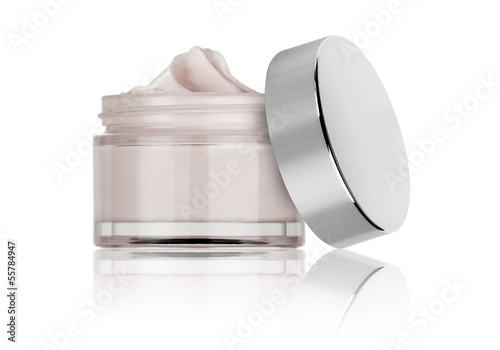 Obraz na plátně  glass jar of beauty cream with cap, isolated