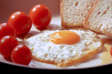 Fried Egg With Bread And Tomat...