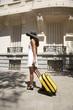 traveler woman walking on sidewalk