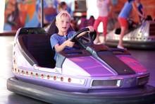 Happy Boys Rides Electric Car At Funfair Entertainment