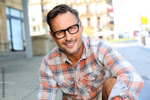 Fototapeta Stylish handsome man in urban scene obraz