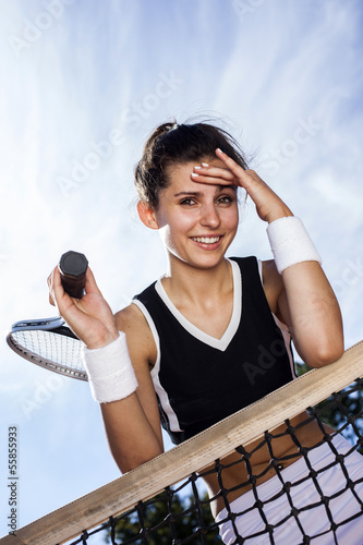 Beautiful young girl rests on a tennis net Poster