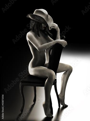 Fototapeta premium Sexy kobieta siedzi na krześle w kapeluszu kowbojskim
