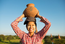 Asian Traditional Female Farmer Carrying Clay Pot
