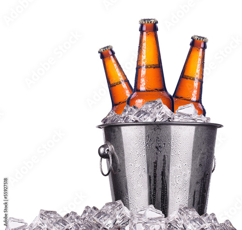Beer bottles in ice bucket isolated Wall mural