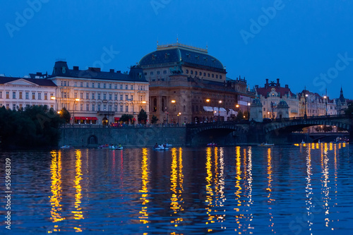 Poster Berlin Prague, view of theater and Vltava Embankment in the evening
