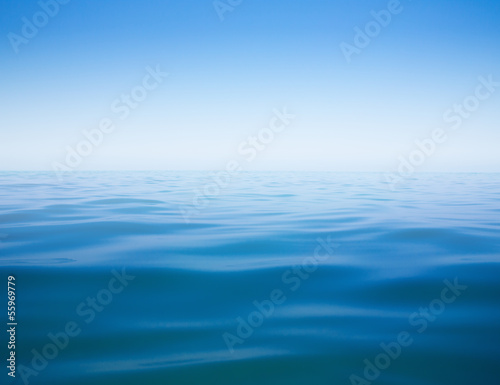 Keuken foto achterwand Zee / Oceaan clear sky and calm sea or ocean water surface background