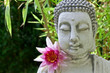 Buddha with lotus flower and bamboo leaves