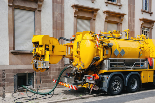 Valokuva  Sewerage truck on city street working