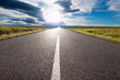 canvas print picture - Driving on empty road towards the sun
