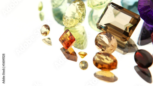 Authentic Gemstones on a mirror with reflection