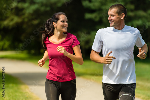 Foto auf AluDibond Jogging Cheerful Caucasian couple running outdoors