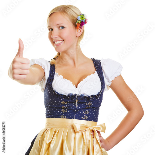 Foto Woman in a dirndl holding thumbs up