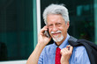 successful businessman is speaking on his smartphone