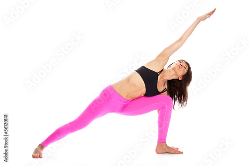 Foto op Plexiglas Fitness Pretty Woman in Yoga Pose - Extended Side Angle Position.