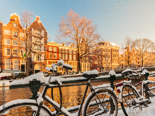 Bicycles covered with snow during winter in Amsterdam Poster