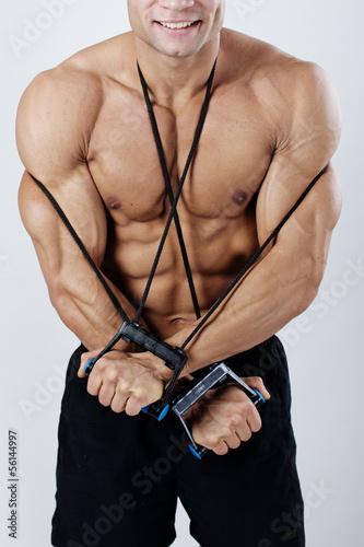 obraz PCV Bardzo dobrze umięśniony mężczyzna w pozie kulturystycznej w strongman